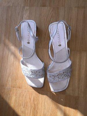 Elegante weiss-glänzende Sandaletten