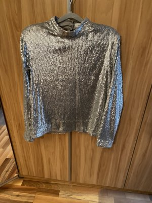 Blusa brillante color plata