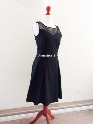 Elegantes schwarzes ärmelloses Kleid mit Spitze und Tellerrock ausgestellt Teadress Skaterkleid