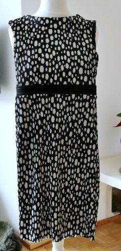 Elegantes schwarzes Kleid mit weißen Punkten