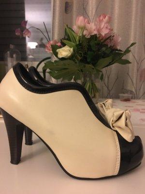 Eleganz schwarz weiss Stiefel