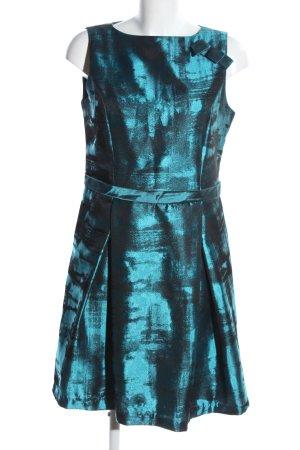 Eleonora Amadei vestido de globo turquesa estampado con diseño abstracto