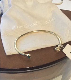 Elizabeth and James Bangle green-gold-colored