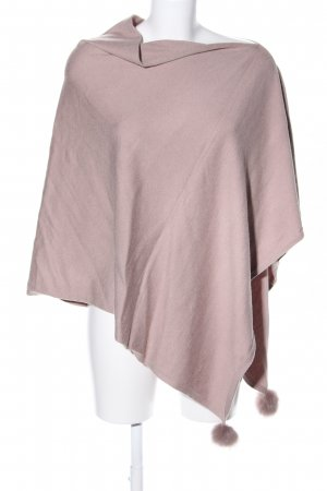 Poncho rosa look casual