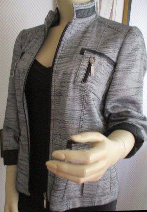 EUGEN KLEIN Jacke Blazer hochwertig! Tweed schwarz weiß Brusttaschen & aufgesetzte Taschen Leder Applikationen  Reißverschluss vorn Gr. 38 40 M