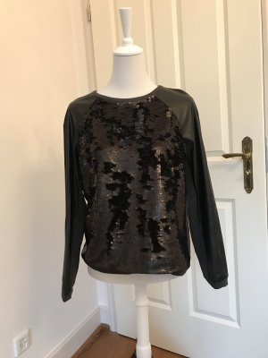 Exclusiver schwarzer Pullover von René Lezard im Materialmix mit Pailetten und veganem Leder