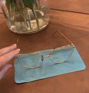 Extravagante Brille in Gold