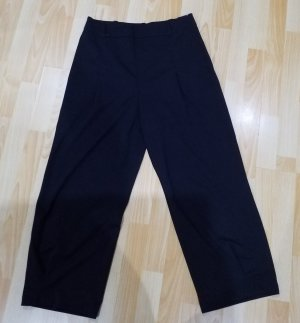 Exzentrische, weit flatternde Benetton Hose, schwarz, Größe 40.