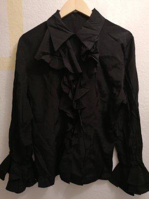 Blusa con volantes negro