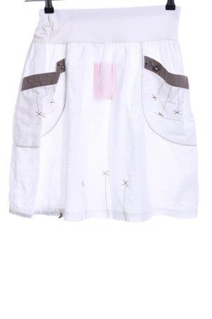 Falda de lino blanco-color bronce look casual