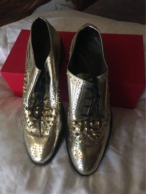 Fast Neue goldene Schuhe