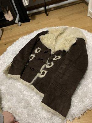Veste en fourrure brun foncé-crème