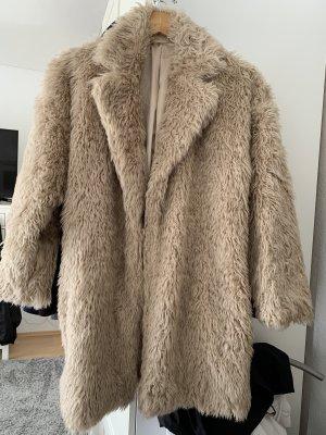Manteau en fausse fourrure crème-beige