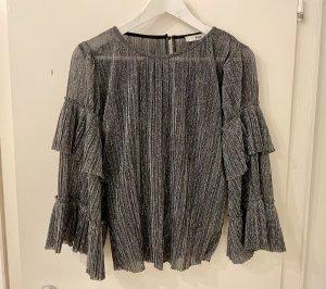 find. Blusa brillante argento-nero