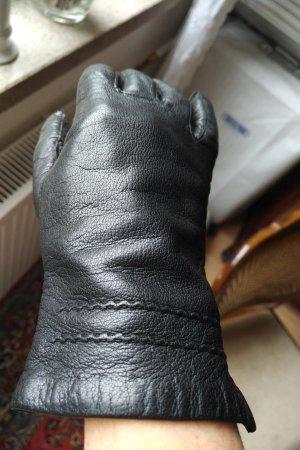 unbekannte Guantes de cuero negro