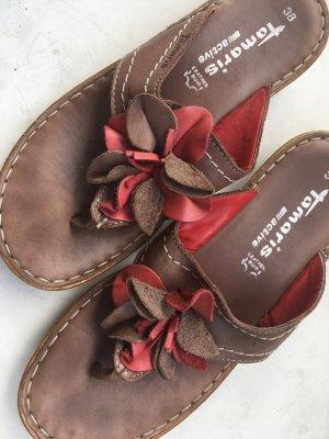 Flip Flops mit starker Sohle und Lederblumen