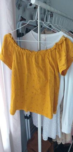 fröhliches gelbes T-Shirt