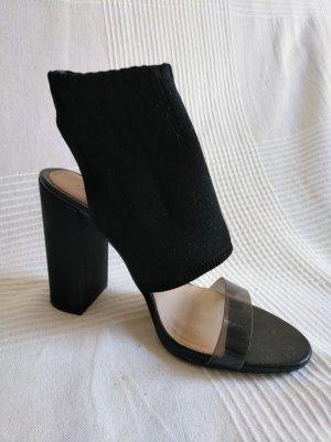Futuristische Sandalen mit Absatz