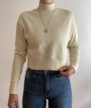 Gelb-grauer Sweater mit Rollkragen