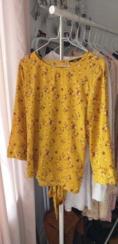 Gelbe Bluse mit Blumen