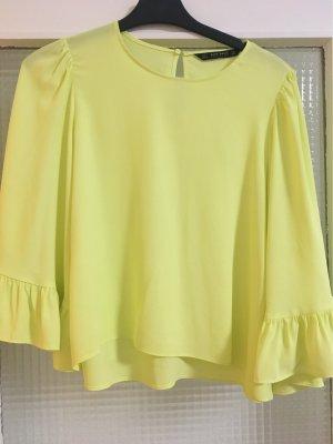 Gelbe Bluse mit weiten Ärmel