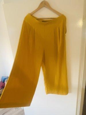 Primark Pantalone a 3/4 giallo-oro