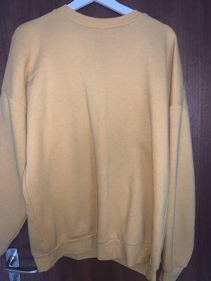Gelber/goldener Pullover