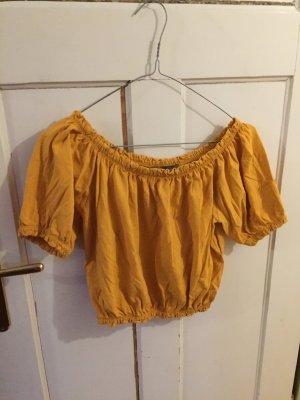 Gelbes bauchfreies Shirt