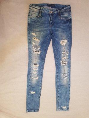 gelochte Jeans