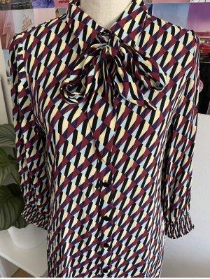Gemustertes Kleid mit Schleifdetails von Zara