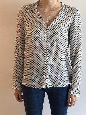 Gepunktete Bluse in schwarz/weiß
