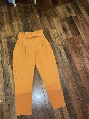 Bershka Pantalone peg-top arancione