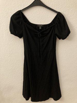 Geripptes schwarzes Minikleid