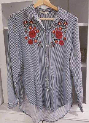 Gestreifte Bluse mit floraler Stickerei