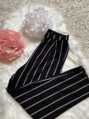 H&M Pantalone a zampa d'elefante nero-bianco