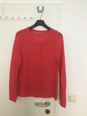 a wear Cardigan en crochet saumon-rouge fluo