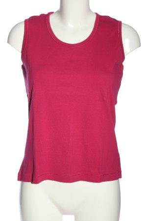 Gina Laura Camiseta sin mangas rosa look casual