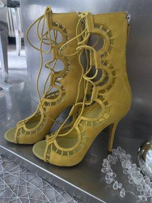 Giuseppe Zanotti Tacones con cordones amarillo