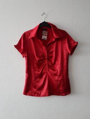 Glänzende Bluse mit Knöpfen von Clockhouse
