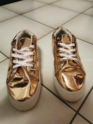Glänzende Plateau Sneaker