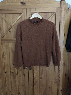 Glänzende Pullover