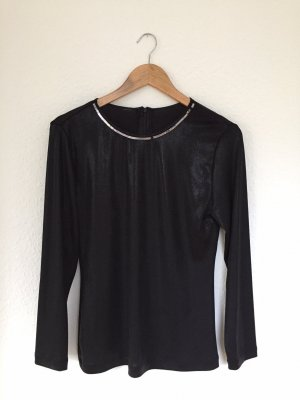 Glänzendes schwarzes Langarmshirt Gr. 40