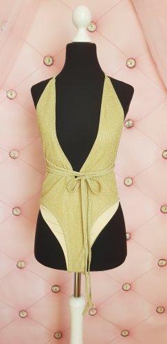 Blusa tipo body color oro