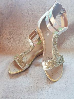 Sandalo con tacco alto e lacci a T argento