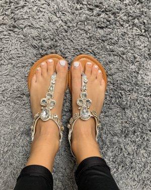 Sandalias con talón descubierto color plata-marrón claro