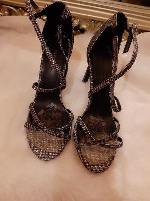 Glitzernde hoche Schuhe