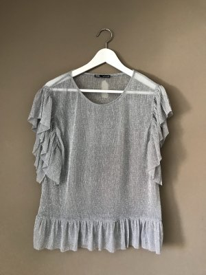 Zara Top con volantes color plata