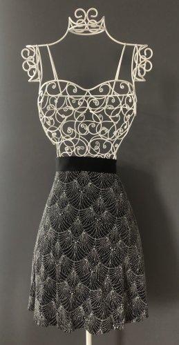 H&M Falda circular negro-color plata