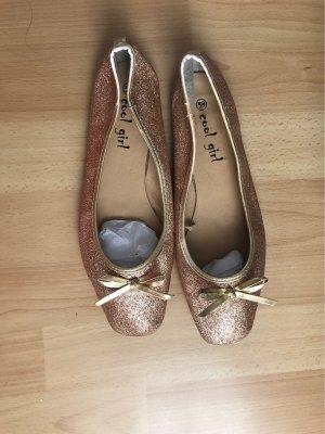 Gold glitzer ballerinas