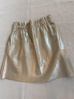 Gold schimmernder Sommerrock mit Taschen